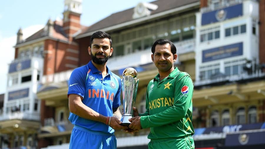 India captain Virat Kohli and Pakistan captain Sarfraz Ahmed hold the ICC Champions Trophy