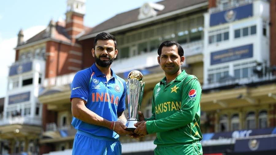 India captain Virat Kohli and Pakistan captain Sarfraz Ahmed hold the ICC Champions Trophy